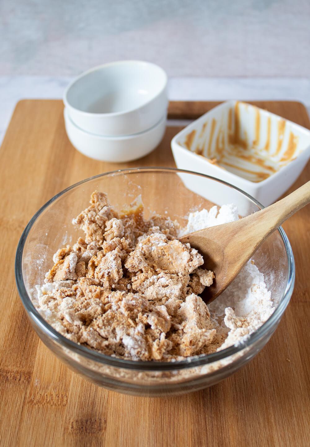 Keto Skippy PB Bites mixing ingredients in bowl